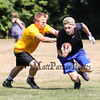 Epping-Newmarket's Shane Moore makes a run while a Bow player makes a tag during Saturday's 7v7 Under Armour Football Tournament between Epping-Newmarket and Bow HS on 7-16-2016 @ Exeter High School.  Matt Parker Photos