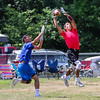 Portsmouth's Shon Parham jumps up to make a catch with a Methuen player covering during Saturday's 7v7 Under Armour Football Tournament vs Methuen MA on 7-16-2016 @ Exeter High School.  Matt Parker Photos
