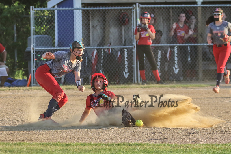 Hurricanes #66 Alicai Habib looses her glove while trying to make a tag on Slammers #2 Jeanine Turgeon as she slides safely into 2nd base during Friday's pool play between the Seacoast Hurricanes and the Rochester Slammers at the Brawl at the Beach Girls U12 Softball Tournament on 7-22-2016 @ Winnacunnet High School, Hampton, NH.  Matt Parker Photos