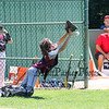 Portsmouth's Catcher #18 Finn Bussiere reaches to make a catch on a foul ball but is not able to do so during Saturday's U9-10 NH Little League State Finals between Portsmouth and Goffstown at Grappone Park, Concord, NH on 7-23-2016.  Matt Parker Photos