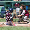 Goffstown's runner #15 Max Ouellette slides safely into home plate while Portsmouth's Catcher #18 Finn Bussiere attempts to make the tag during Saturday's U9-10 NH Little League State Finals between Portsmouth and Goffstown at Grappone Park, Concord, NH on 7-23-2016.  Matt Parker Photos