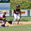 Portsmouth's Short Stop #00 Timmy Avery picks up a hit ball while Goffstown Runner #9 Ryan Strand is looking to go 3rd during Saturday's U9-10 NH Little League State Finals between Portsmouth and Goffstown at Grappone Park, Concord, NH on 7-23-2016.  Matt Parker Photos