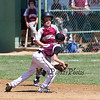 Portsmouth's #00 Timmy Avery is unable to avoid the tag by Goffstown's 2nd baseman #12 Alex Magdziasz while running to 2nd base during Saturday's U9-10 NH Little League State Finals between Portsmouth and Goffstown at Grappone Park, Concord, NH on 7-23-2016.  Matt Parker Photos