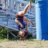 A young Gymnasists performing flips at Friday's Div I Boys home opener Soccer game between Winnacunnet and Concord High Schools @ WHS on 8-26-2016.  Matt Parker Photos