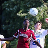Winnacunnet's #23 Ben Allen and Concord's #7 Ngongo Mungeta go up for a head ball during Friday's Div I Boys home opener Soccer game between Winnacunnet and Concord High Schools @ WHS on 8-26-2016.  Matt Parker Photos