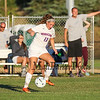 Winnacunnet's #12 Ally Giacalone gets control of the ball while Winnacunnet Coach Nick O'Brien points her in the right direction during Tuesday's NHIAA DIV I Girls Soccer game between Winnacunnet and Salem High Schools on 9-13-2016 @ WHS.  Matt Parker Photos