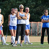 Winnacunnet's Head Coach Heidi Hand center with Assistant Coach Jennifer Roy and players watch the action on the field from the sidelines during Wednesday's NHIAA DIV I Girls Field Hockey between Winnacunnet and Timberlane High Schools on 9-14-2016 @ WHS.  Matt Parker Photos