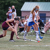 Winnacunnet's #18 Audrey Canfield takes the ball down the sideline with Timberlane's #3 Em Lisi defending during Wednesday's NHIAA DIV I Girls Field Hockey between Winnacunnet and Timberlane High Schools on 9-14-2016 @ WHS.  Matt Parker Photos