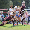 Winnacunnet's Co-Captain #5 Isobel Sargent  gets pressure from Timberlane defenders #4 Tori Rothwell and #14 Julia Lanctot as she works the ball up the sideline during Wednesday's NHIAA DIV I Girls Field Hockey between Winnacunnet and Timberlane High Schools on 9-14-2016 @ WHS.  Matt Parker Photos