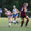 Winnacunnet's #6 Abby Merrill takes a shot on goal as Timberlane's #18 Taryn MacKinnon takes cover during Wednesday's NHIAA DIV I Girls Field Hockey between Winnacunnet and Timberlane High Schools on 9-14-2016 @ WHS.  Matt Parker Photos