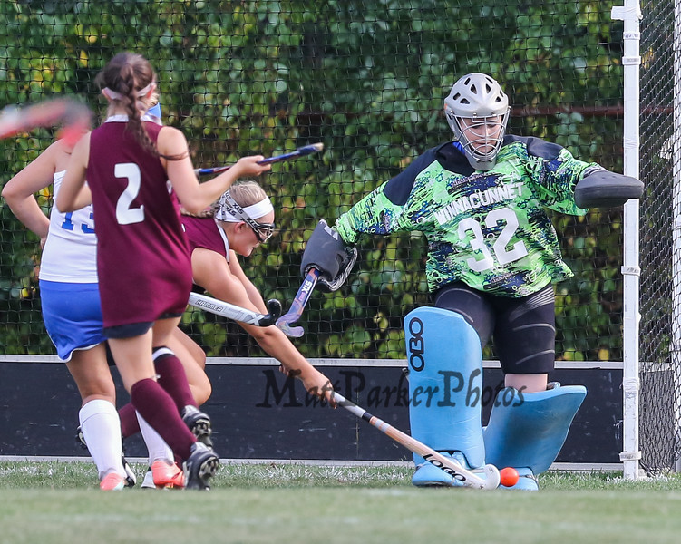 Winnacunnet's Goal Keeper #32 Nikki Tredwell steps out to kick the ball away on a shot by Timberlane's #11 Ky Fitzpatrick during Wednesday's NHIAA DIV I Girls Field Hockey between Winnacunnet and Timberlane High Schools on 9-14-2016 @ WHS.  Matt Parker Photos