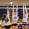 Winnacunnet's #10 Sarah Taylor and #12 Steph Rheaume jump to attempt to block a shot by Owls #18 Tori Boutin during Tuesday's NHIAA DIV I Girls Volleyball game between Winnacunnet and Timberlane High Schools on 9-14-2016 @ WHS.  Matt Parker Photos