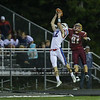 Winnacunnet's WR #12 Evan Welch leaps to make a great catch with Clippers #81 Hunter Adams defending.  The Play was called back due to a Winnacunnet holding call during Friday's NHIAA DIV I Football game between Winnacunnet and Portsmouth High Schools on 9-16-2016.  Matt Parker Photos