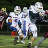 Winnacunnet's #6 Mason Partner looks for the opening created by #59 Bryce Libby during Friday's NHIAA DIV I Football game between Winnacunnet and Portsmouth High Schools on 9-16-2016.  Matt Parker Photos