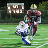 Portsmouth's RB #1 Shon Parham is forced out of bounds by Winnacunnet's #84 Max Clark  during Friday's NHIAA DIV I Football game between Winnacunnet and Portsmouth High Schools on 9-16-2016.  Matt Parker Photos