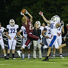 Portsmouth's #21 Owen Kane makes an interception off a Winnacunnet throw intended for #81 Logan Keene late in the 4th quarter during Friday's NHIAA DIV I Football game between Winnacunnet and Portsmouth High Schools on 9-16-2016.  Matt Parker Photos