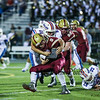 Portsmouth's QB #9 Cody Graham is tackled by Winnacunnet's #65 Menas William on a running play during Friday's NHIAA DIV I Football game between Winnacunnet and Portsmouth High Schools on 9-16-2016.  Matt Parker Photos