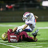 Winnacunnet's RB #3 Billy Powers is tackled by Portsmouth's #81 Hunter Adams during Friday's NHIAA DIV I Football game between Winnacunnet and Portsmouth High Schools on 9-16-2016.  Matt Parker Photos