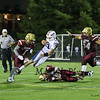 Winnacunnet's QB #17 Patrick MacDougall gets tripped up during a running play by Clippers #81 Hunter Adams with #54 Alex Gladu and #1 Shon Parham closing in during Friday's NHIAA DIV I Football game between Winnacunnet and Portsmouth High Schools on 9-16-2016.  Matt Parker Photos