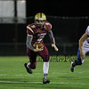 Portsmouth's QB #9 Cody Graham scrambles for yards during Friday's NHIAA DIV I Football game between Winnacunnet and Portsmouth High Schools on 9-16-2016.  Matt Parker Photos