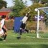 Winnacunnet's Goal Keeper Dominic Stiles jumps to make a save with the ball going wide at Tuesday's NHIAA DIV I Boys Soccer game between Winnacunnet and Bedford High Schools on 9-20-2016.  Matt Parker Photos