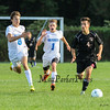 Winnacunnet's #8 Zach Waterhouse and #1 Danny Webb-McClain with Bedford's #4 Ryan sledjeski race to recover the ball at Tuesday's NHIAA DIV I Boys Soccer game between Winnacunnet and Bedford High Schools on 9-20-2016.  Matt Parker Photos