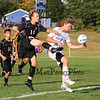Bedford's #11 Charley Speaker gets his foot on the ball with Winnacunnet's #20 Kevin Gagnon defending at Tuesday's NHIAA DIV I Boys Soccer game between Winnacunnet and Bedford High Schools on 9-20-2016.  Matt Parker Photos