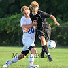 Bedford's #11 Charley Speaker and Winnacunnet's #20 Kevin Gagnon collide as they hustle for a loose ball at Tuesday's NHIAA DIV I Boys Soccer game between Winnacunnet and Bedford High Schools on 9-20-2016.  Matt Parker Photos