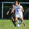 Winnacunnet's #5 Drew Forsley keeps the ball from Bedford's #15 Alexander Quinones at Tuesday's NHIAA DIV I Boys Soccer game between Winnacunnet and Bedford High Schools on 9-20-2016.  Matt Parker Photos