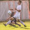 Bedford's #12 Devon Garrett takes a shot from the corner with Winnacunnet's #10 Nick Quinlan defending at Tuesday's NHIAA DIV I Boys Soccer game between Winnacunnet and Bedford High Schools on 9-20-2016.  Matt Parker Photos