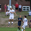 Winnacunnet's #5 Drew Forsley leaps in the air to get his head on a high kicked ball during Friday's NHIAA DIV I Boy Soccer game between Winnacunnet and Exeter High Schools on 9-23-2016 @ WHS.  Matt Parker  Photos