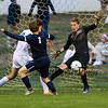 Exeter's #1 Lee Veader's shot is saved by Goal Keeper Dominic Stiles with Winnacunnet's #9 Joe Gyorda during Friday's NHIAA DIV I Boy Soccer game between Winnacunnet and Exeter High Schools on 9-23-2016 @ WHS.  Matt Parker  Photos