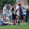 Winnacunnet's #5 Drew Forsley tries to keep the ball inbounds with Exeter's #2 Chris Scamman defending during Friday's NHIAA DIV I Boy Soccer game between Winnacunnet and Exeter High Schools on 9-23-2016 @ WHS.  Matt Parker  Photos