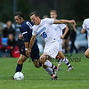 Exeter's #10 Jacob Gould and Winnacunnet's #16 Freddy Schaake race for the ball during Friday's NHIAA DIV I Boy Soccer game between Winnacunnet and Exeter High Schools on 9-23-2016 @ WHS.  Matt Parker  Photos