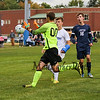 Exeter's Goal Keeper #00 Caden Blazek steps out to make a save with Winnacunnet's #8 Zach Waterhouse looking to make a play with Exeter's #16 Matt Olszewski trailing in Friday's HIAA DIV I Boy Soccer game between Winnacunnet and Exeter High Schools on 9-23-2016 @ WHS.  Matt Parker  Photos