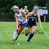 Winnacunnet's #7 Rachel Ingham runs the ball up the field with Exeter's #5 Valerie Damsell trailing at Friday's NHIAA DIV 1 Girls Field Hockey game between Winnacunnet and Exeter High Schools on 9-23-2016 @ WHS.  Matt Parker Photos