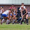 Exeter's #9 Olivia Hampe gets double-teamed by Winnacunnet's #12 Lauren Alkire and #2 Alyssa Crochietierre as she takes the ball down the sideline during Friday's NHIAA DIV 1 Girls Field Hockey game between Winnacunnet and Exeter High Schools on 9-23-2016 @ WHS.  Matt Parker Photos
