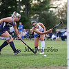 Winnacunnet's #10 Dana Sher takes a shot with Exeter's #13 Grace Holler defending at Friday's NHIAA DIV 1 Girls Field Hockey game between Winnacunnet and Exeter High Schools on 9-23-2016 @ WHS.  Matt Parker Photos