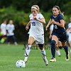 Winnacunnet's #10 Claire Gourgeot gets a break and hustles the ball up the field with Exeter's #12 Jen Rogers trailing  during Friday's DIV I Girls Soccer game between Winnacunnet and Exeter High Schools on 9-23-2016 @ WHS.  Matt Parker Photos