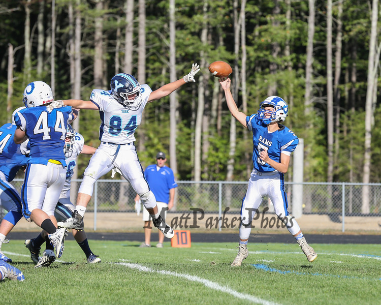 Ram's QB #5 Tripp Bush throws a pass with Wildcats #84 Jake Nelson jumping to make a block at Saturday's Campbell Conference Football game between York and Kennebunk High School on 9-24-2016 @ Kennebunk, ME.  Matt Parker Photos