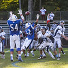 York's QB #7 Trevor LaBonte throws an interception pass into the big hands of Rams DL Cole Hoffman who then runs the ball for a couple yards at Saturday's Campbell Conference Football game between York and Kennebunk High School on 9-24-2016 @ Kennebunk, ME.  Matt Parker Photos
