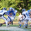 Rams #42 Evan Enis runs the ball with York defenders closing in at Saturday's Campbell Conference Football game between York and Kennebunk High School on 9-24-2016 @ Kennebunk, ME.  Matt Parker Photos