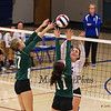Winnacunnet's #15 Lily Martin puts the ball over the net with Dover's #11 Hannah Jelley and #17 Sarah Quinn defending during Monday Night's Girls NHIAA DIV I Volleyball game between Winnacunnet and Dover High Schools on 9-26-2016 @ WHS.  Matt Parker Photos