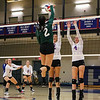 Dover's #2 Brynn Coleman jumps to spike the ball with Winnacunnet's #12 Stephanie Rheume and #4 Sadie Gaskell defending during Monday Night's Girls NHIAA DIV I Volleyball game between Winnacunnet and Dover High Schools on 9-26-2016 @ WHS.  Matt Parker Photos