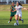 Dover's #12 Sara Hinman breaks up a pass by Winnacunnet's #17 Jess Vogel during Tuesday's NHIAA DIV I Girls Soccer game between Winnacunnet and Dover High Schools on 9-27-2016.  Matt Parker Photos