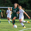 Dover's #19 Maggie Casey and Winnacunnet's #14 Colleen Kennedy fight for the ball during Tuesday's NHIAA DIV I Girls Soccer game between Winnacunnet and Dover High Schools on 9-27-2016.  Matt Parker Photos