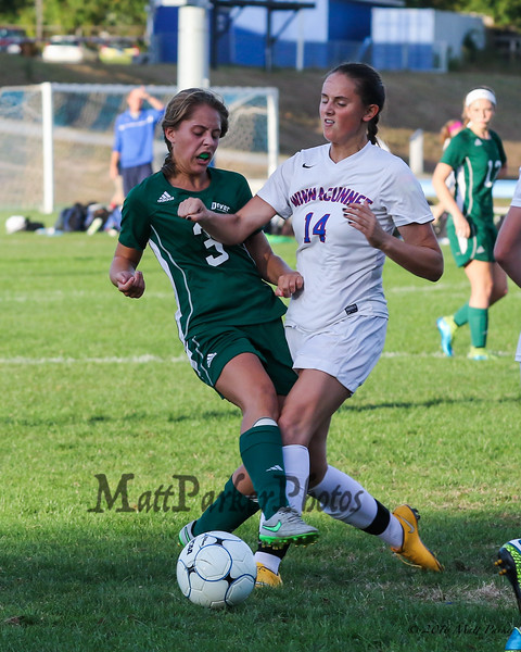 Winnacunnet's #14 Colleen Kennedy and Dover's #3 Peyton Aubin make a play on the ball during Tuesday's NHIAA DIV I Girls Soccer game between Winnacunnet and Dover High Schools on 9-27-2016.  Matt Parker Photos