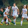 Winnacunnet's #14 Colleen Kennedy takes control of the ball after  Dover's #2 Jordan Woodman made a play on the Winnacunnet net  with Winnacunnet's #20 Leah Orzechowski and #1 Ali McNamara helping to defend during Tuesday's NHIAA DIV I Girls Soccer game between Winnacunnet and Dover High Schools on 9-27-2016.  Matt Parker Photos