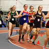 winnacunnet's Casey McNamara (5:58.90) runs with a pack of runners in the Girls 1500m run during Sunday's NH Indoor Track and Field League Evening Session @ The Paul Sweet Oval @ UNH on 1-10-2016.  Matt Parker Photos