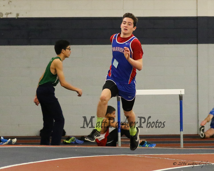 Winnacunnet's Brennan Kittredge rounds the corner in the Boys 300m Dash finishing with a time of 43.80 during Sunday's NH Indoor Track and Field League Evening Session @ The Paul Sweet Oval @ UNH on 1-10-2016.  Matt Parker Photos